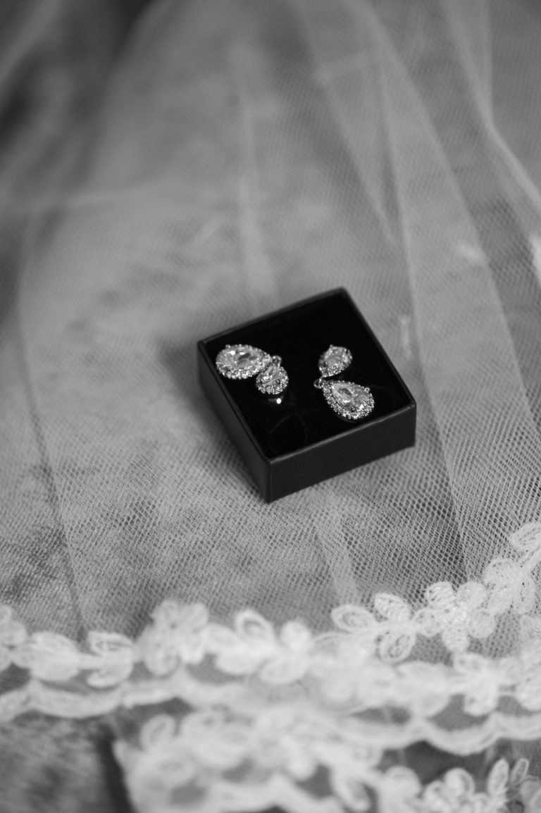 wedding photography at Tudor Barn in Eltham - the brides earrings