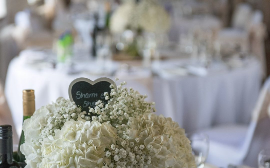 Wedding photography at Tudor Barn in Eltham - table flowers