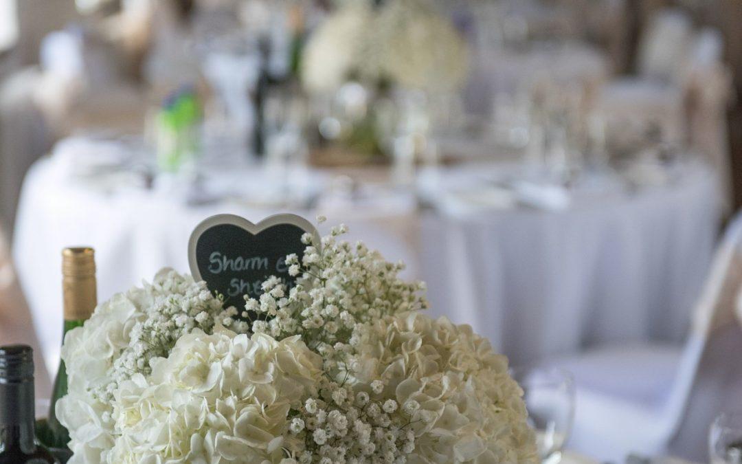 Wedding photography at Tudor Barn in Eltham - table flowers