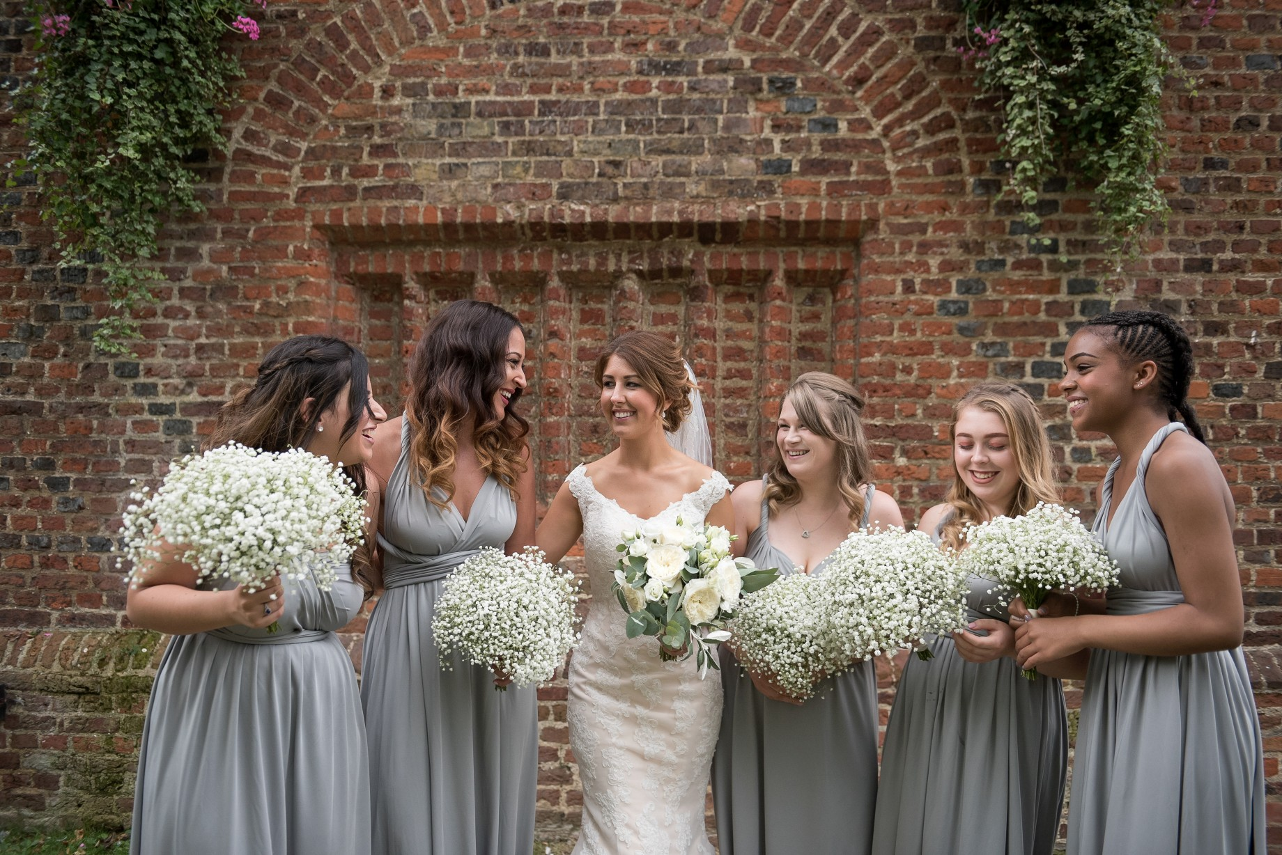 Wedding photography at Tudor Barn in Eltham - bride and bridesmaids