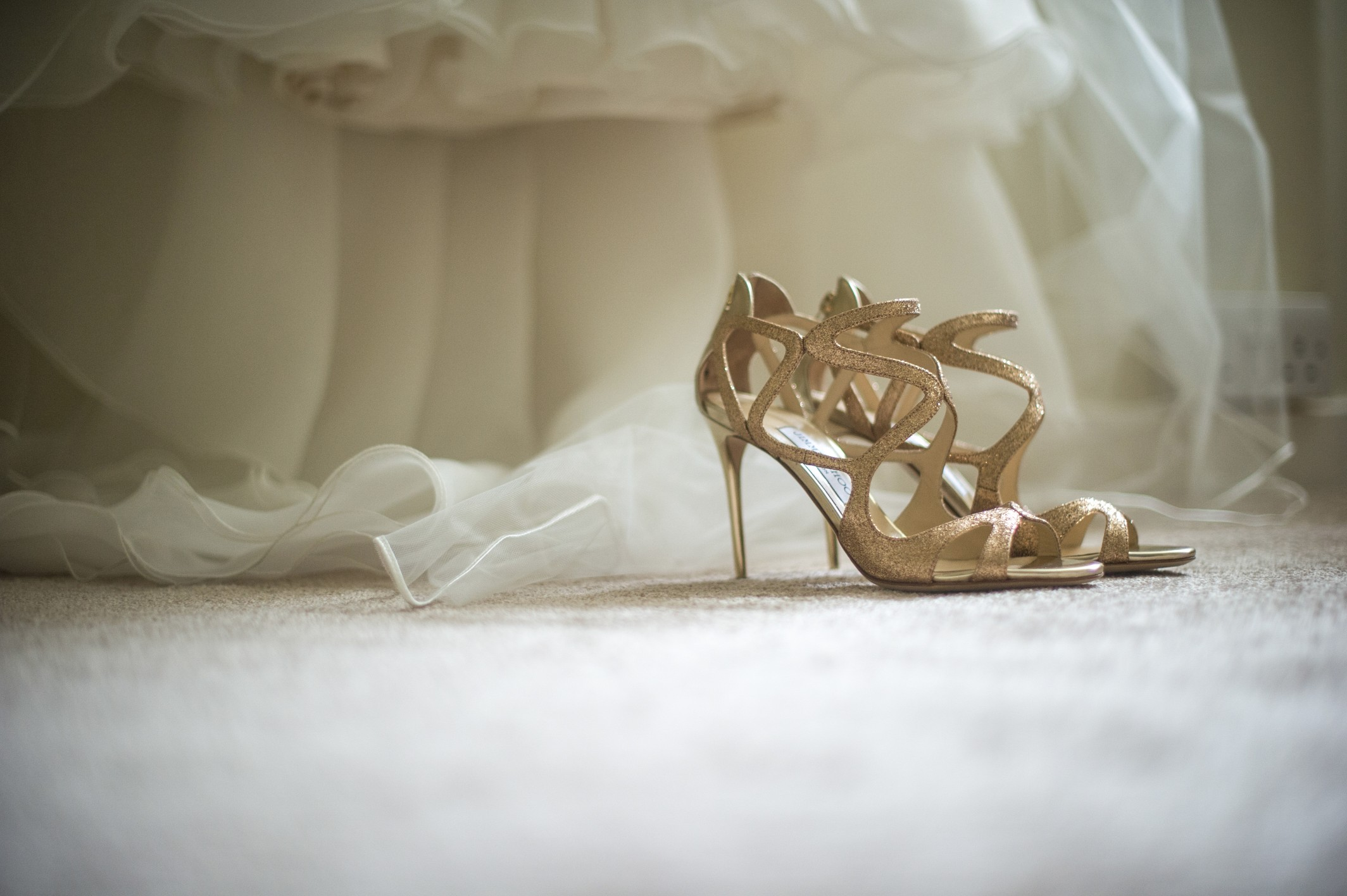 Wedding photography at Farnham Castle in Surrey - brides shoes