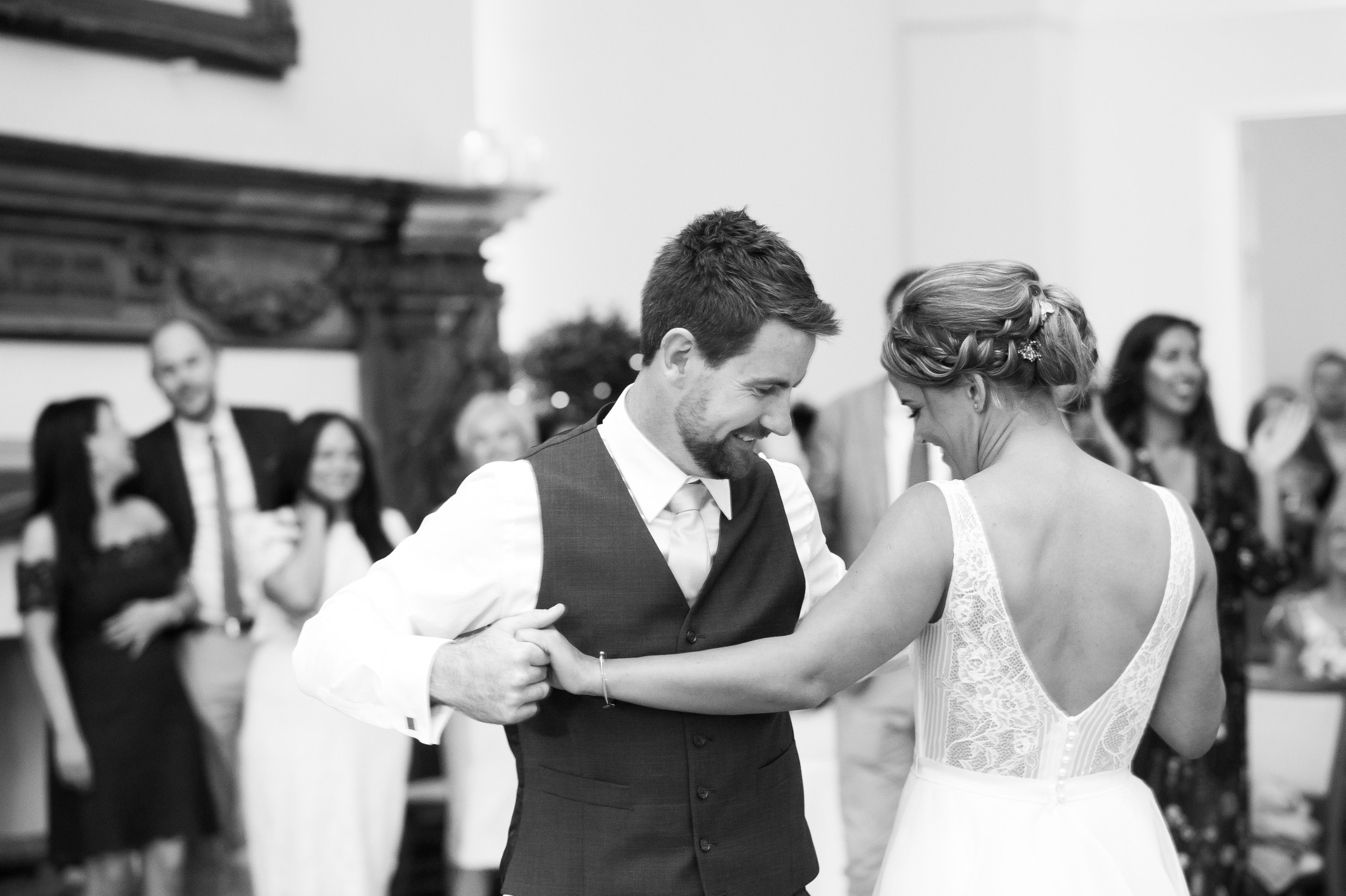 Wedding photography at Farnham Castle in Surrey - the bride and groom first dance