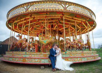 Wedding photography at Preston Court in Canterbury - the fairground ride