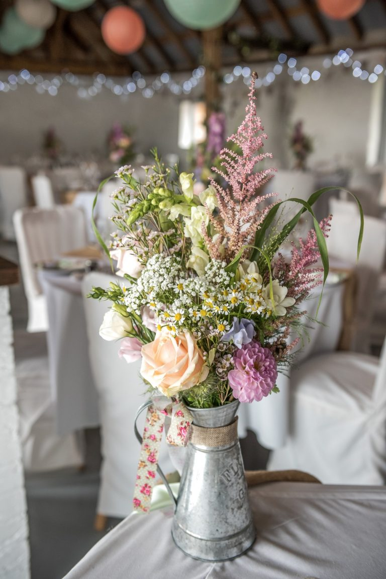 Wedding photography at Red Barn in Capel - the table flowers