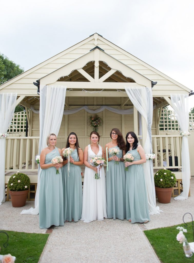 Wedding photography at Red Barn in Capel - the bride & bridesmaids