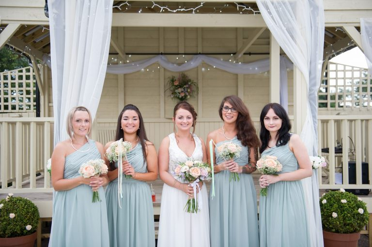 Wedding photography at Red Barn in Capel - the bride and bridesmaids