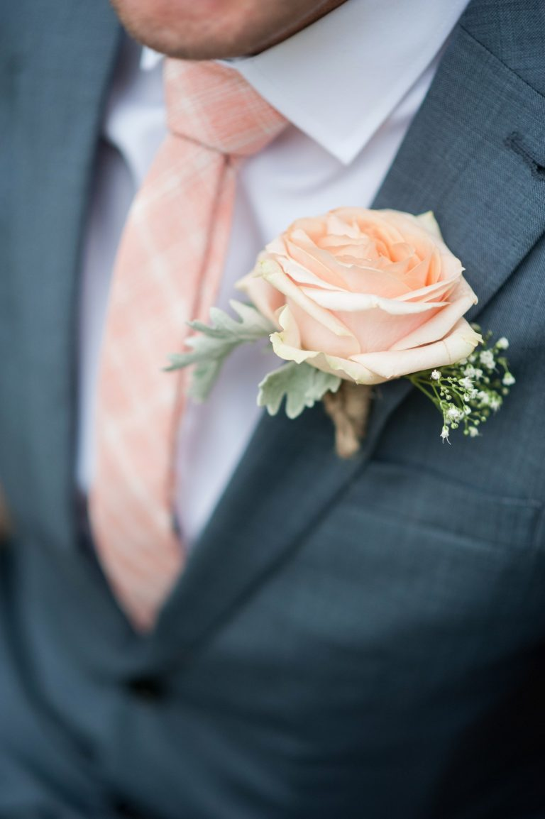 Wedding photography at Red Barn in Capel - the buttonhole flowers