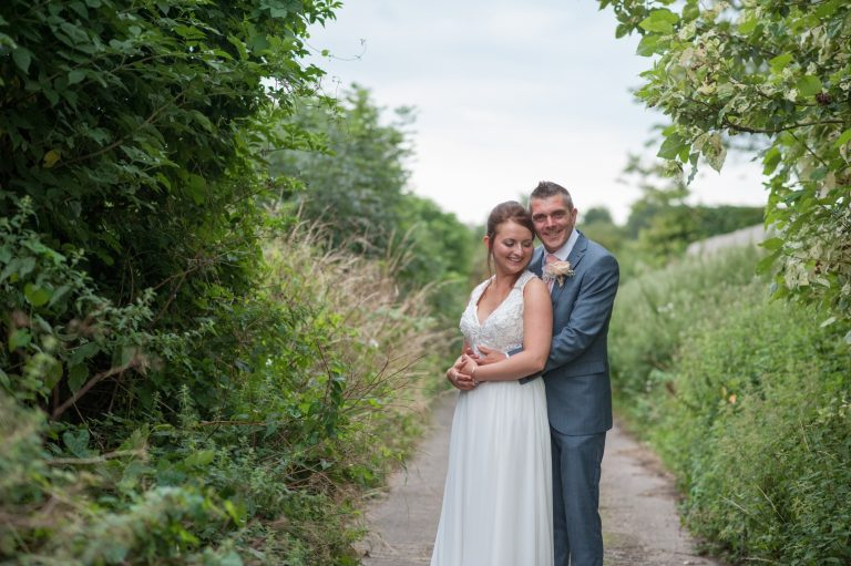 Wedding photography at Red Barn in Capel - the bride and groom