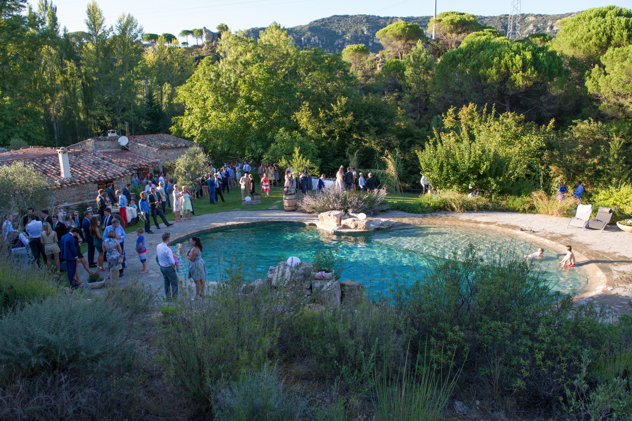 Wedding photography - South of France wedding - guests by the pool